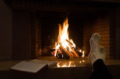 Book near the fireplace royalty free stock photo