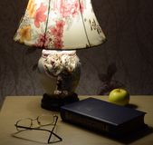 Evening at home, lamp and book. Good book before sleep Stock Image