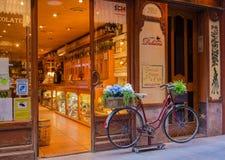 Evening illuminated antique shop bicycle Stock Image