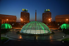 Evening illumination in Almaty - Kazakhstan. Evening illumination of Almaty Kazakhstan. Underground shopping mall in foreground Royalty Free Stock Photos