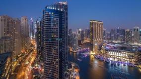 Evening illumination of Dubai Marina day to night aerial timelapse, UAE. Evening illumination of Dubai Marina day to night transition aerial timelapse, UAE stock video footage