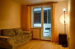 Evening interior of a small guest room royalty free stock photo
