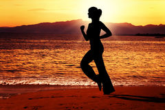 Evening jog along the beach. Royalty Free Stock Photo