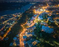 Evening Kiev, Ukraine. Aerial view. Panoramic aerial view of evening Kiev above Andrews Descent and St. Andrews Church with the Dnieper River in the background stock photo