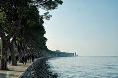 Evening 'La passeggiata' along the Garda Lake edge in Peschiera del Garda, Lago di Garda, Italy Royalty Free Stock Images