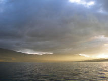 Evening on the lake. With hills on horizon, in Ecuador, South America royalty free stock photos