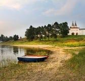 Evening at the lake. Boats. Monastery. Feropontovo Stock Photography