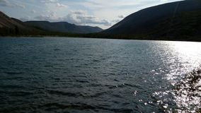 Evening lake in Kolyma stock images