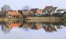 Evening on the lake side, typical village, Poland. Royalty Free Stock Photos