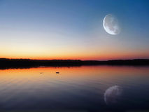 Evening lake under the Moon Royalty Free Stock Images