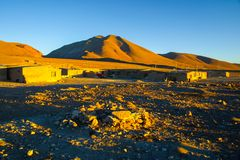 Evening landscape and accomodation buldings at Laguna Colorada, Altiplano area, Bolivia, South America.  stock photography