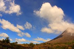 Evening landscape with the Arenal volcano (Costa R. Evening landscape with the Arenal volcano in Costa Rica. Wide-angle lens Stock Photos