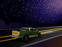 Evening landscape. The car rides on the highway. Lights illuminate the road car. Landscape with the car. Starry sky Royalty Free Stock Photos