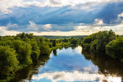 Evening landscape with dramatic sky with clouds and river Royalty Free Stock Photography