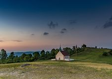 Evening landscape of the famous hill Walberla with the Walpurgis chapel at the franconian suisse in Bavaria in south Germany Royalty Free Stock Images