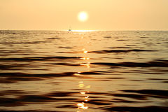 Evening landscape golden sunset. Reflection of the sun into the sea at sunset in golden tones Royalty Free Stock Images