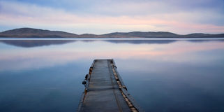Evening landscape of lake. With pier Royalty Free Stock Photos