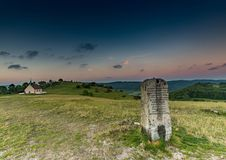 Evening landscape and a mile stone on the famous hill Walberla at the franconian suisse in Bavaria in south Germany Royalty Free Stock Photos