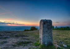 Evening landscape and a mile stone on the famous hill Walberla at the franconian suisse in Bavaria in south Germany Royalty Free Stock Image