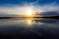 Evening landscape with nice sunset over lake Stock Photography