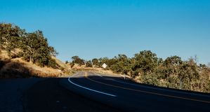Scenic rural road in Sierra Nevada, California, USA royalty free stock photography