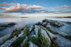 Evening landscape of stony coast of the lake Royalty Free Stock Photos