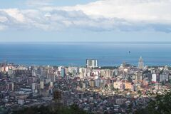 Evening landscape. Top view of the Black sea, the sea port of Batumi against the background of white clouds.