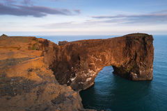 Evening landscape with views of the rocky cape and ocean in Iceland. Beautiful summer landscape with rocky cape and ocean. Southern coast of Iceland. View of royalty free stock photography