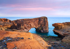 Evening landscape with views of the rocky cape and ocean in Iceland royalty free stock photos