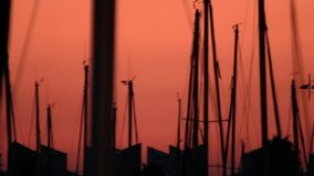 Evening landscape yacht silhouette standing in seaport. Sunst yacht. Boat port. Evening landscape yacht silhouette standing in sea port. Boat mast parked in stock video footage