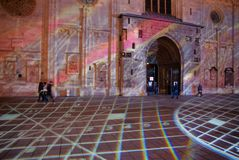 Evening Laser show at Stephansplatz St Stephen Cathedral in Vienna. Vienna, Austria - January 8, 2014: Evening Laser show at Stephansplatz at the entrance of St royalty free stock photo