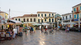 Evening in Lefkada Town, Greece. The central square in Lefkada, an Ionian Greek Island, at dusk, with children playing and people at tavernas, restaurants and royalty free stock photos