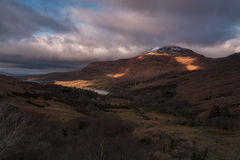 Evening light falls on snow capped mountain Royalty Free Stock Images