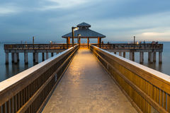Evening light on the fishing pier in Fort Myers Beach. Evening light on the fishing pier in Fort Myers Beach, Florida Stock Photos
