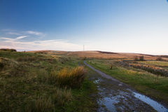 Evening light on hilltop with radio mast Stock Photos