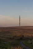 Evening light on hilltop with radio mast Royalty Free Stock Photography