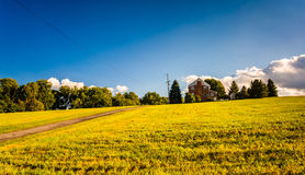 Evening light on a house in a field, York County, Pennsylvania. Stock Photo