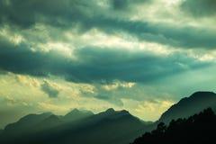 Evening light through the mountains Stock Photo
