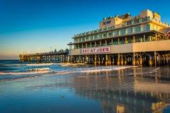 Evening light on the pier in Daytona Beach, Florida. Royalty Free Stock Photo