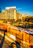 Evening light on railroad cars and buildings in Philadelphia, Pe Stock Photos