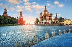 Evening light on Red Square. The St. Basil`s Cathedral and the Spassky Tower in the rays of the setting sun stock photos