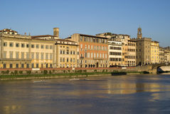 Evening light on riverbank of the Arno in downtown Florence Stock Photo