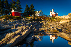 Evening light on rocks and Pemaquid Point Lighthouse, Maine. Royalty Free Stock Photo