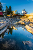 Evening light on rocks and Pemaquid Point Lighthouse, Maine. Royalty Free Stock Image