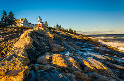 Evening light on rocks and Pemaquid Point Lighthouse, Maine. Royalty Free Stock Images