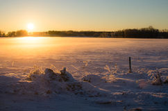 Evening light at sunset in the Estonian winter. January snow in the Baltic countryside of Turi, Järva County & x28;Järvamaa& x29;, Estonia royalty free stock image