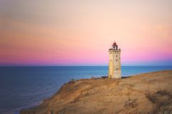 Rubjerg Knude Lighthouse standing on a cliff in Denmark stock photos