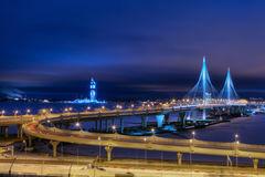 Evening lighting cable stayed bridge on highway, St. Petersburg, Russia. Saint-Petersburg, Russia - December 28, 2016: Cable-stayed bridge across the Petrovsky stock photo