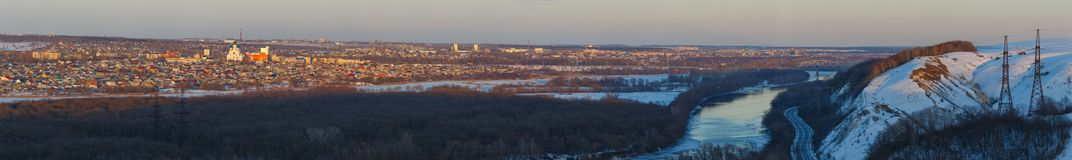 Evening lighting over the city. Sunset time in the twilight sky. Panoramic top view of residential district.  stock image