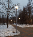 Evening lighting in park. Street lamps. Russia, Moscow Stock Images